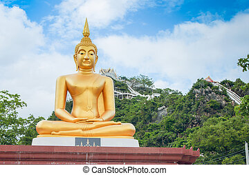Buddha statues on blue sky and mountain as background