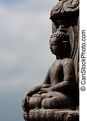 Buddha surrounded by clouds - Statue of Buddha sitting in...
