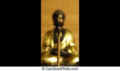 Buddha with incense stick