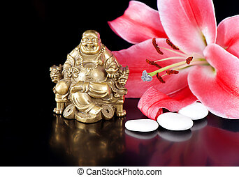 buddha with stones and lily flower