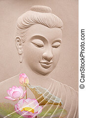 buddha wooden carving. Mural paintings tell the story about the Buddha's history.
