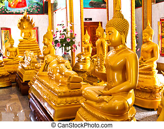 Buddhas inside the Wat Chalong temple, Phuket, Thailand.