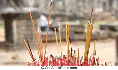 Buddhism. Aromatic sticks in temples and pagodas of Asia -...
