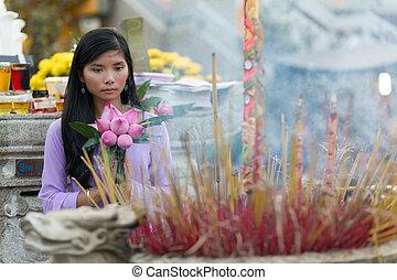 Buddhist Asian woman praying