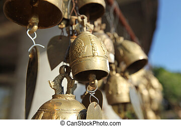 Buddhist bells with wishes - Many golden buddhist bells with...