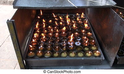 buddhist candle fire in Katmandu