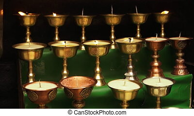 Buddhist candle lamps on stairs, Mulbekh temple - Close up...