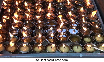 buddhist candles fire in Katmandu
