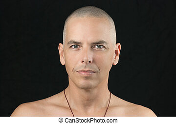 Buddhist Looks To Camera - Close-up of a buddhist man...