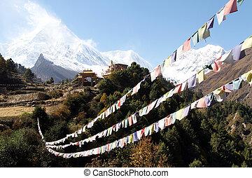 Buddhist monastery and flags near Manaslu in Nepal