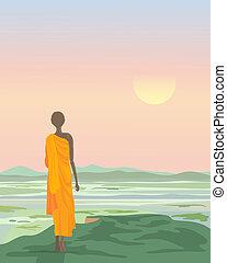 buddhist monk at sunset