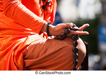 Buddhist monk hand detail, the monk in praying.