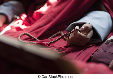 Buddhist Monk With Prayer Beads - Monks at the sacred thread...