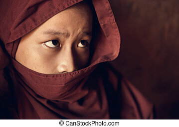 Buddhist novice monk covered with robe