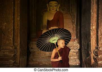 Buddhist novice monk inside monastery