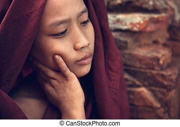Buddhist novice monk portrait - Portrait of young novice...