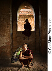 Buddhist novice monks inside temple