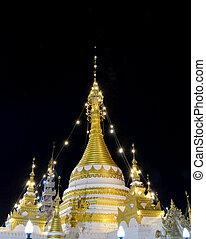 Buddhist Pagoda on Black Sky Background