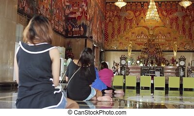 buddhist people pray in temple