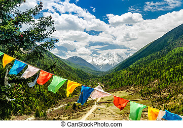 Buddhist prayer flags before Mount Yala in Sichuan Province - China