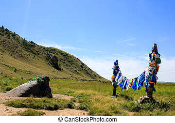 Buddhist prayer flags on ritual poles - Colorful buddhist...