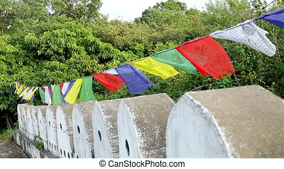 Buddhist prayer flags swaying in the wind