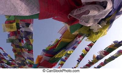 buddhist prayers flag on bouddhnath stupa and camera motion,...