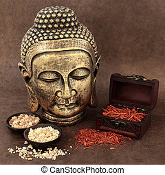 Buddhist Ritual - Gold buddha with incense of frankincense,...