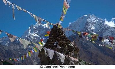 Buddhist stupa and snow mountain