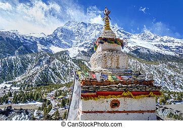 Buddhist stupa with the Annapurna III - Old Buddhist stupa...