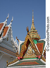 Buddhist Temple - A Buddhist temple with ornate golden...