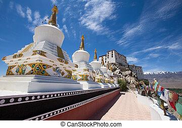 Buddhist white stupa and blue sky . Thiksey Monastery, Leh ,...