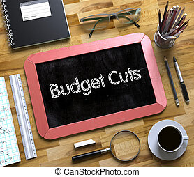 Budget Cuts Handwritten on Small Chalkboard. 3D Rendering.