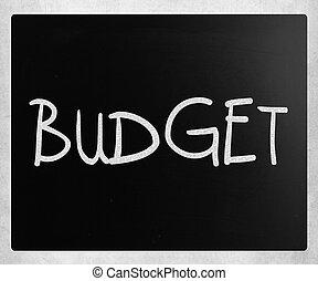 """Budget"" handwritten with white chalk on a blackboard"
