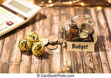 Budget money jar savings motivational concept