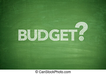 Budget on Blackboard - Budget text on green Blackboard with...