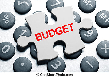 Budget - calculator and Puzzle, business concept of Budget