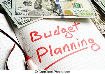 Budget Planning handwritten in a note and money.