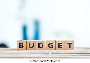 Budget sign on a wooden table