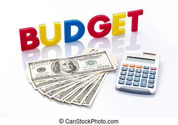 Budget words, American banknotes and calculator on white...