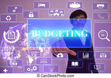 BUDGETING concept presented by businessman touching on virtual screen ,image element furnished by NASA