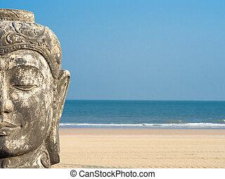 Budha against a blue sky