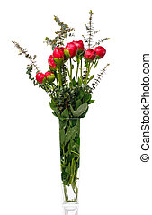 Buds of peonies and eucalyptus leaves in a glass vase on a white background.