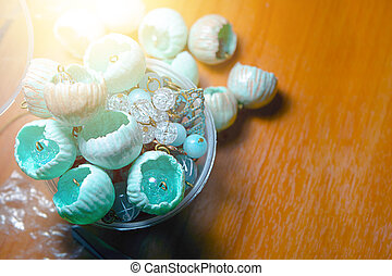 Buds of polymer clay on the wooden desk