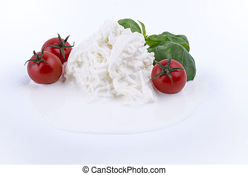 Buffalo mozzarella cheese made from milk Alibovalo on white background with tomatoes