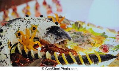 buffet, beautiful fish lying on the dish