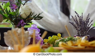 Buffet, cheese and fruit looks beautiful on the table