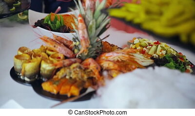 buffet: crawfish and shrimp are on the plate.