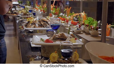 Buffet in a luxurious restaurant with fish, snacks and vegetables. Celebration concept, food