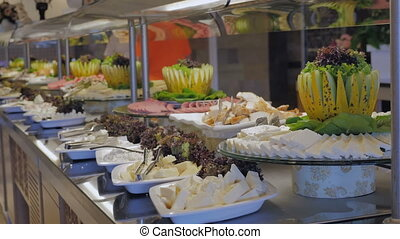Buffet in the restaurant. Appetizer of cheese.